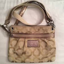 coach poppy beige purse with pink interior