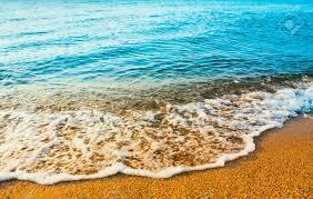 Ocean Wave Background Sea Ocean Waves Wash Over Golden Sand Beach Background Stock Photo