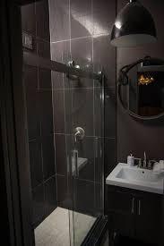 black bathroom. 6 Tags Modern 3/4 Bathroom With Frameless Showerdoor, Ann Sacks Lume Mosaics Sticks, Undermount Black B