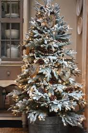 Our Frosted Frazier Fir is 5 1/2' tall and I placed it in a big vintage  galvanized bucket with wooden handles.