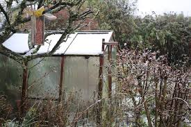 greenhouse covered in snow
