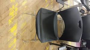 black hard plastic stack chairs with metal legs