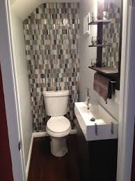 small bathroom with glass tile backsplash for the home