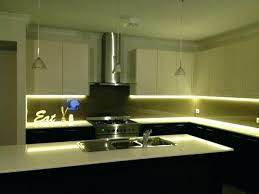 above kitchen cabinet lighting under led strip and brushed nickel pendant lamp with clear glass shade