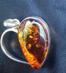heart pendant with amber mounted on 925 silver