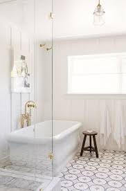 these concrete tiles add a lot of interest to an otherwise plain bathroom i love the all white room with a splash of tada on the floor