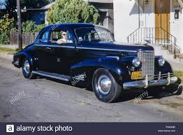 black and chrome old 2 door cadillac sedan american car with a 1956 california licence plate image taken in 1962