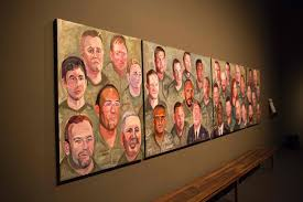 paintings of wounded us military veterans painted by former us president george w bush hang in portraits of courage a new exhibit at the george w bush