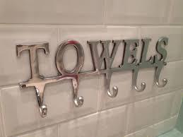 modern towel rack. Modern Towel Rack With Signature Word For Unique Bathroom Idea