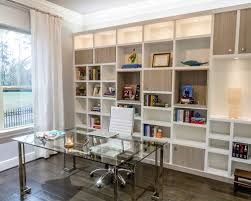 Mid-sized minimalist freestanding desk dark wood floor study room photo in  Los Angeles with