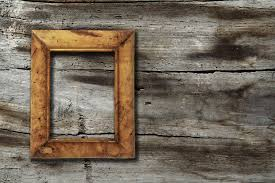blank photo frame on old wooden background