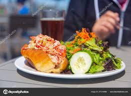 Lobster roll with salad and beer ...