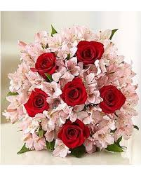 red roses in a pink bunch flowers of