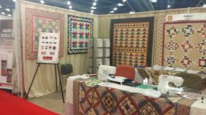 Our Booth at Houston International Quilt Market » SQangles & Deborah, Lori and Sue have worked so hard on getting the booth all set up  for the Houston International Quilt Market! We thought you might like a  look! Adamdwight.com