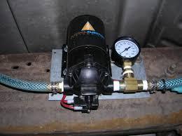 pump placement under passenger side door on frame