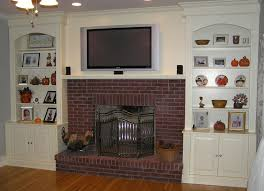 fireplace built in bookcase with cabinet around brick