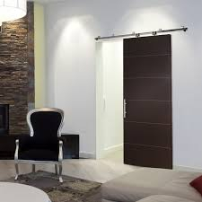 remarkable black painted single barn doors interior with white wall painted feat stones wall exposed also silver finished armchair in modern living room