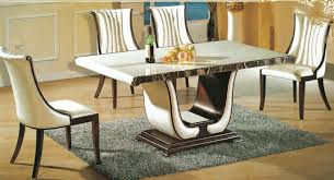 now is the round sy base marble table that uses a um thick top on top of a mive wooden structure pair this dining table with leather chairs