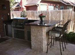 outdoor kitchen with stone bar