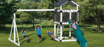 children enjoying an authentic amish made swing set from adventure world playsets
