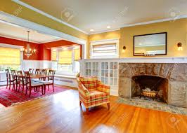 Yellow And Red Living Room Gentle Yellow Living Room With Stone Fireplace And Built In