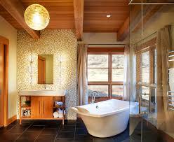 fabulous hanging lamp above dark floortile in rustic bathroom ideas with white bathtub near window