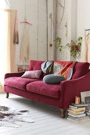 dark pink sofa and whitewashed brick walls