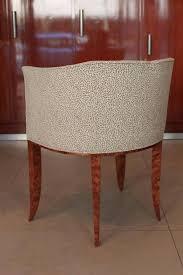 las vanity stool with burled veneers and custom upholstery subtle details like the graceful splay