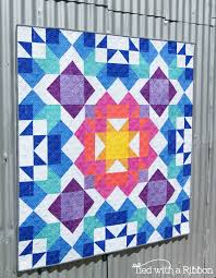 how to design a quilt on graph paper tied with a ribbon aurora quilt pattern release