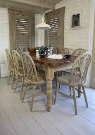 shabby chic pedestal dining table metal glass finish dining table base beige wall paint black tufted