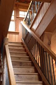 fabulous eclectic staircase natural wood with rough hewn wood wood grain with custom railing and