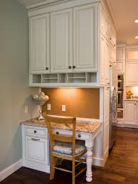 This custom-designed kitchen desk area features plenty of storage, granite  countertops and a
