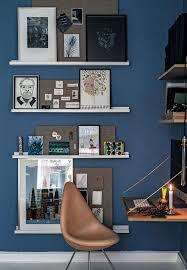 gallery unique home office. stylish home office with decorative gallery shelves lithographs and drawings the drop chair in brown leather is from arne jacobsen unique