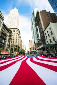 u s department of defense photo essay service members and participants in the veterans day parade carry the american flag up fifth avenue