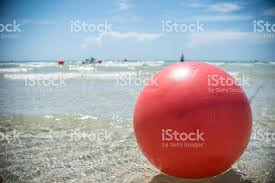 Beach ball in ocean Floating Red Beach Ball In Ocean Royaltyfree Stock Photo Istock Red Beach Ball In Ocean Stock Photo More Pictures Of Adventure