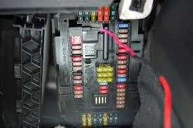 passenger side front fusebox location page  disconnect the cable that goes to the light by pulling the connector straight out then look up and you ll see the fusebox you can see my piggyback fusetap