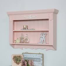 ornate pink wall shelf unit