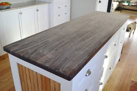 sand your butcher block countertops before you apply a pure tung oil finish
