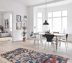 all white room with oriental rug