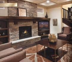 natural stone fireplace with wood mantel trinity