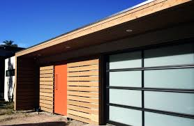 Biowood Black Brown battens facade and garage door.