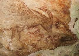 a photo of cave paintings in the limestone cave on the indonesian side of sulawesi