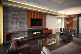 this modern living room has a long rectangular fireplace built into the entertainment center the