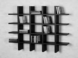 Black Wooden Crossed Rectangle Books Shelves Placed On The Wall
