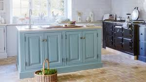 by melanie griffiths october 15 2018 designing a stylish kitchen on a budget painting plain kitchen cabinets is the
