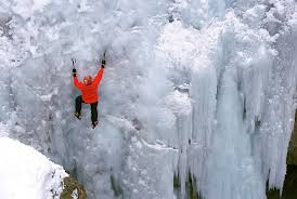 Image result for An ice climber ascends a waterfall near Lake City, Colorado