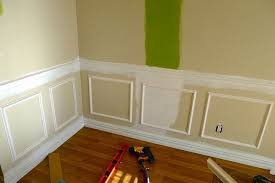 diy add molding beneath a chair rail her way looks easier than others i ve seen