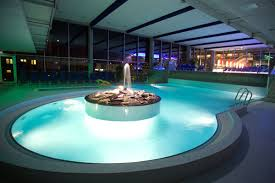luxury indoor swimming pool design with rounded shape and hot tub with amazing lighting private luxury amazing indoor pool lighting
