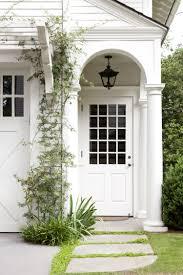 carriage house entry porch trellis over garage doors