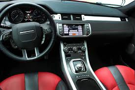 land rover 2014 black. with handsome brushed aluminum panels and red black leather seats the interior of land rover 2014
